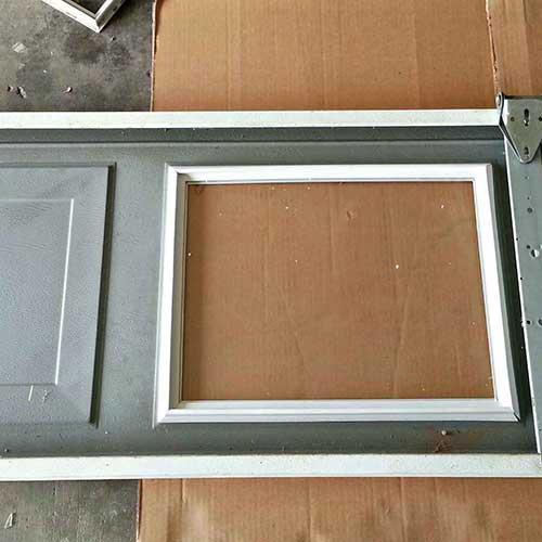 Broken-Panel-Garage-Door-Repair